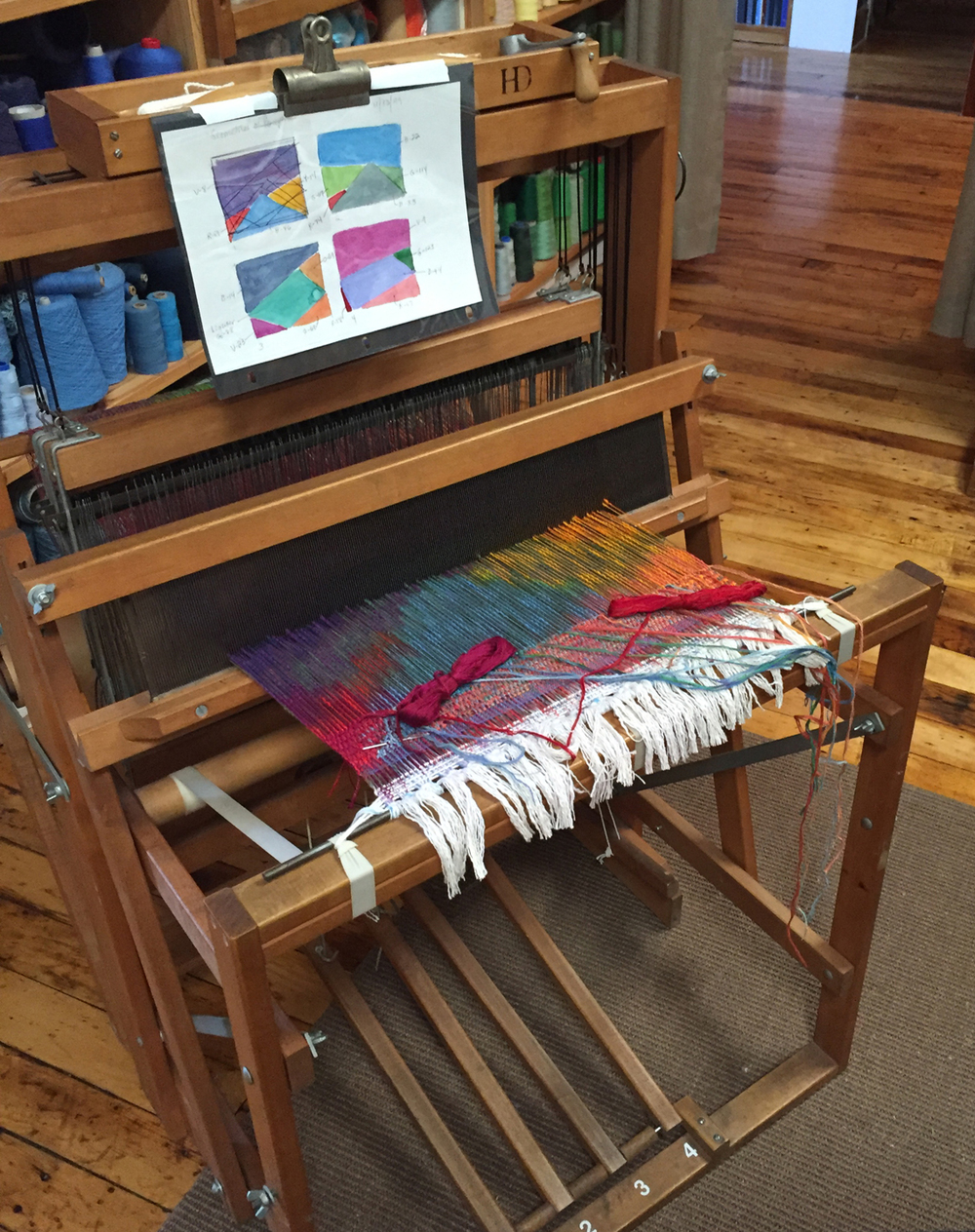Betty's small loom with a warp-painted, hand-woven tapestry in progress.
