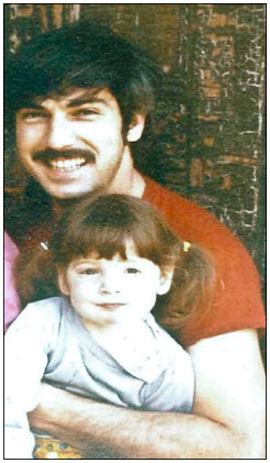 Annie at 2 with her father