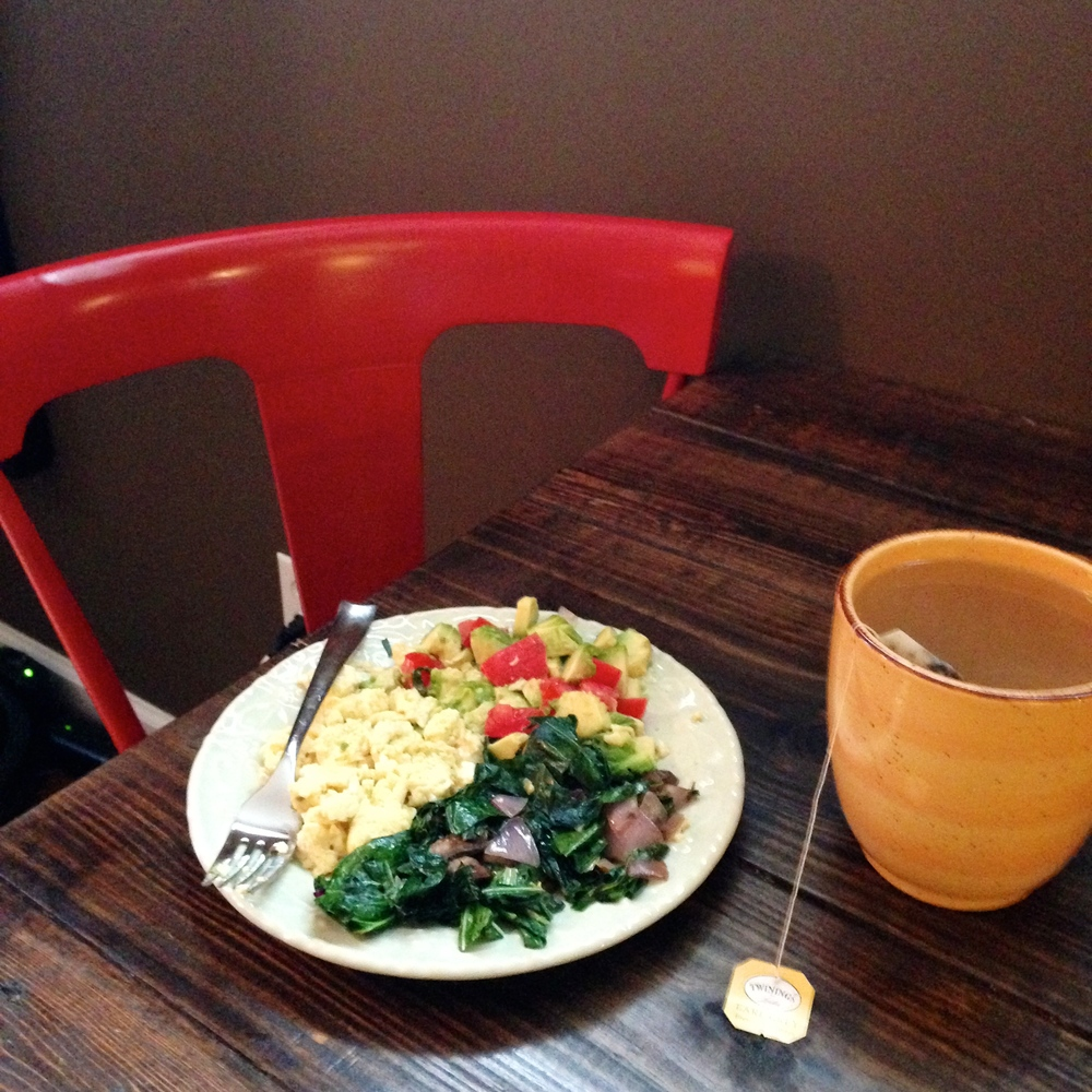 Impressive, over the top breakfast: Scrambled eggs, sautéed collards, onions, mushrooms in coconut oil with a side of fresh avocado and tomato slices.