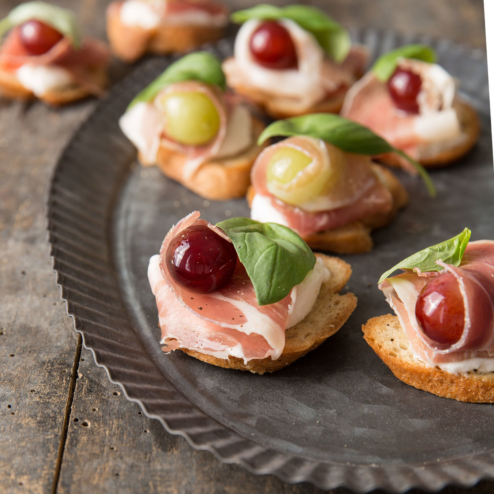 Grape, Burrata and Proscuitto Crostini