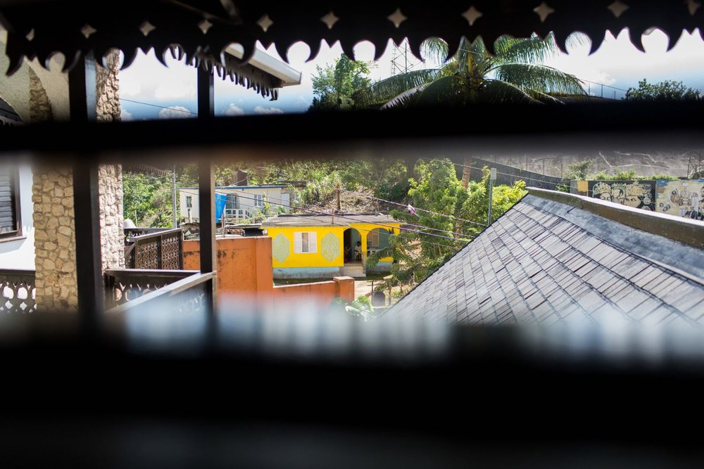 "Shot through the blinds, a house outside of the Marley ""tourist"" complex."