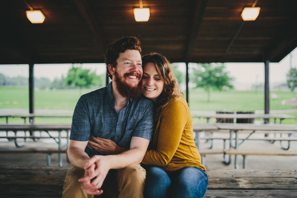 Engagement portrait of Maryland couple outside at a park.