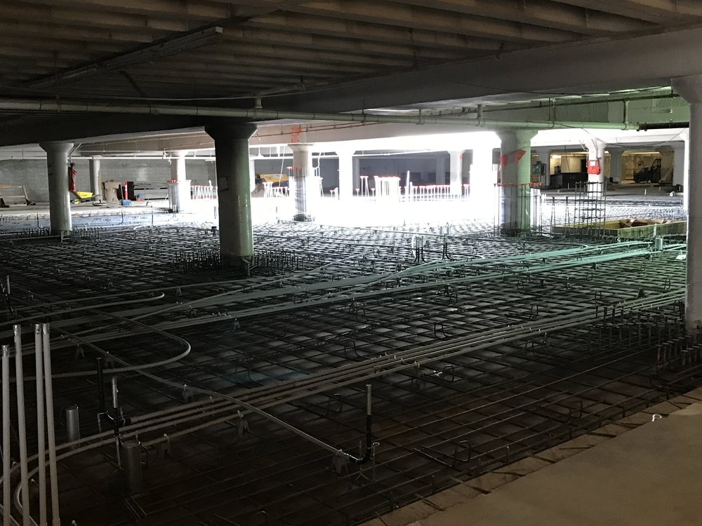 Rebuilding parking decks for new library basement