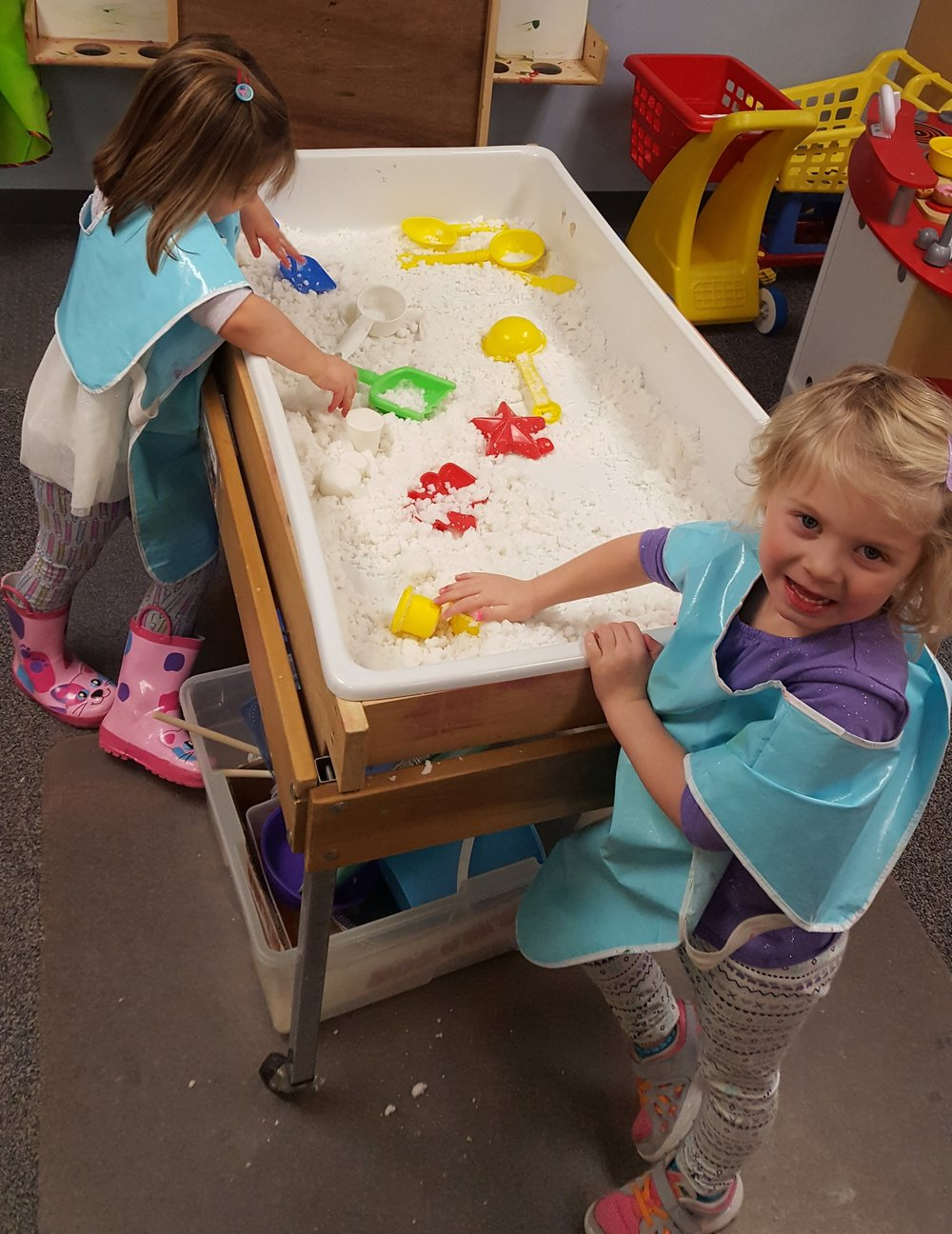 At the sensory table students practice using their senses to explore the world and make observations. Here, students play with artificial snow.  If the winter doesn't bring outdoor snow, make your own!