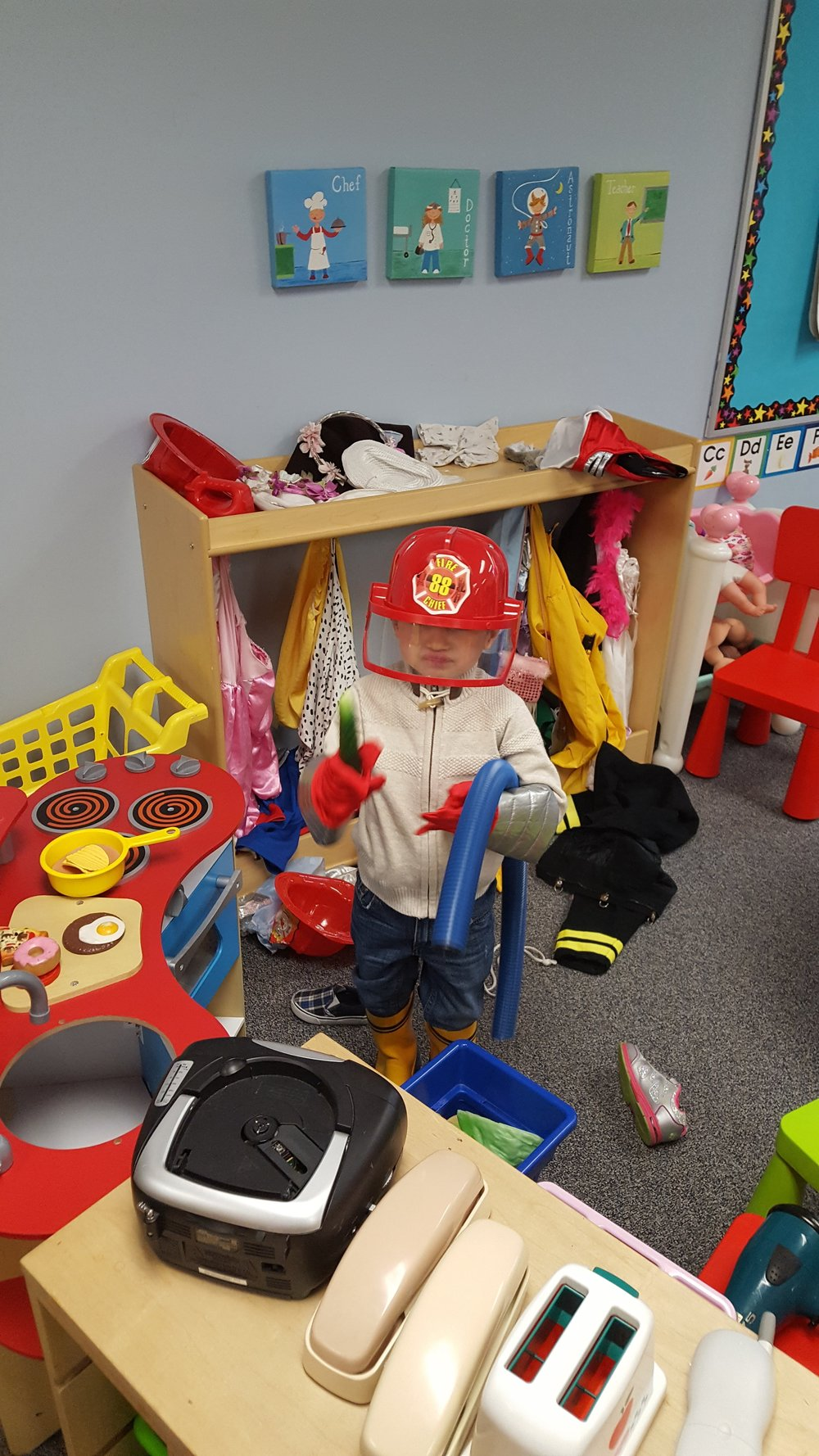 Through dramatic play, our young fire-fighter is strengthening language skills, developing problem-solving skills and excercising his imagination!