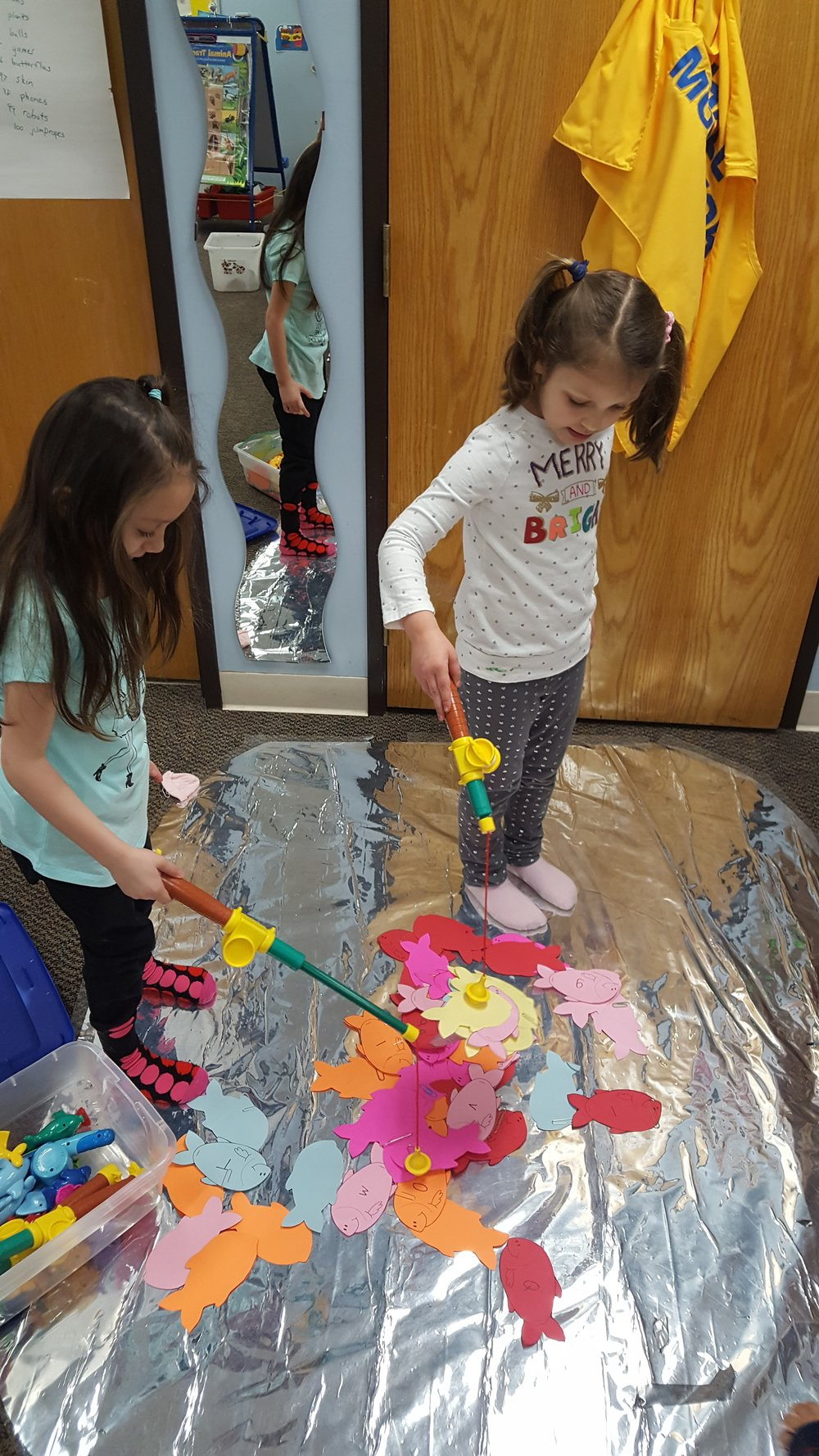 "These young ladies are participating in a more structured teacher-designed activity They are ""fishing"" for lower case letters. Our classroom centers provide both student-directed and teacher-directed learning opportunities."