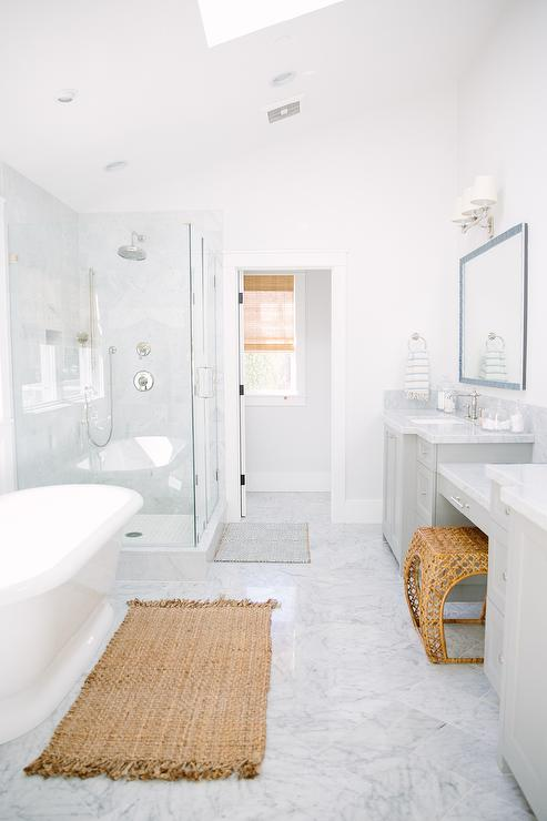 master-bathroom-sloped-ceiling-skylight-gray-vanity-diamond-pattern-floor.jpg