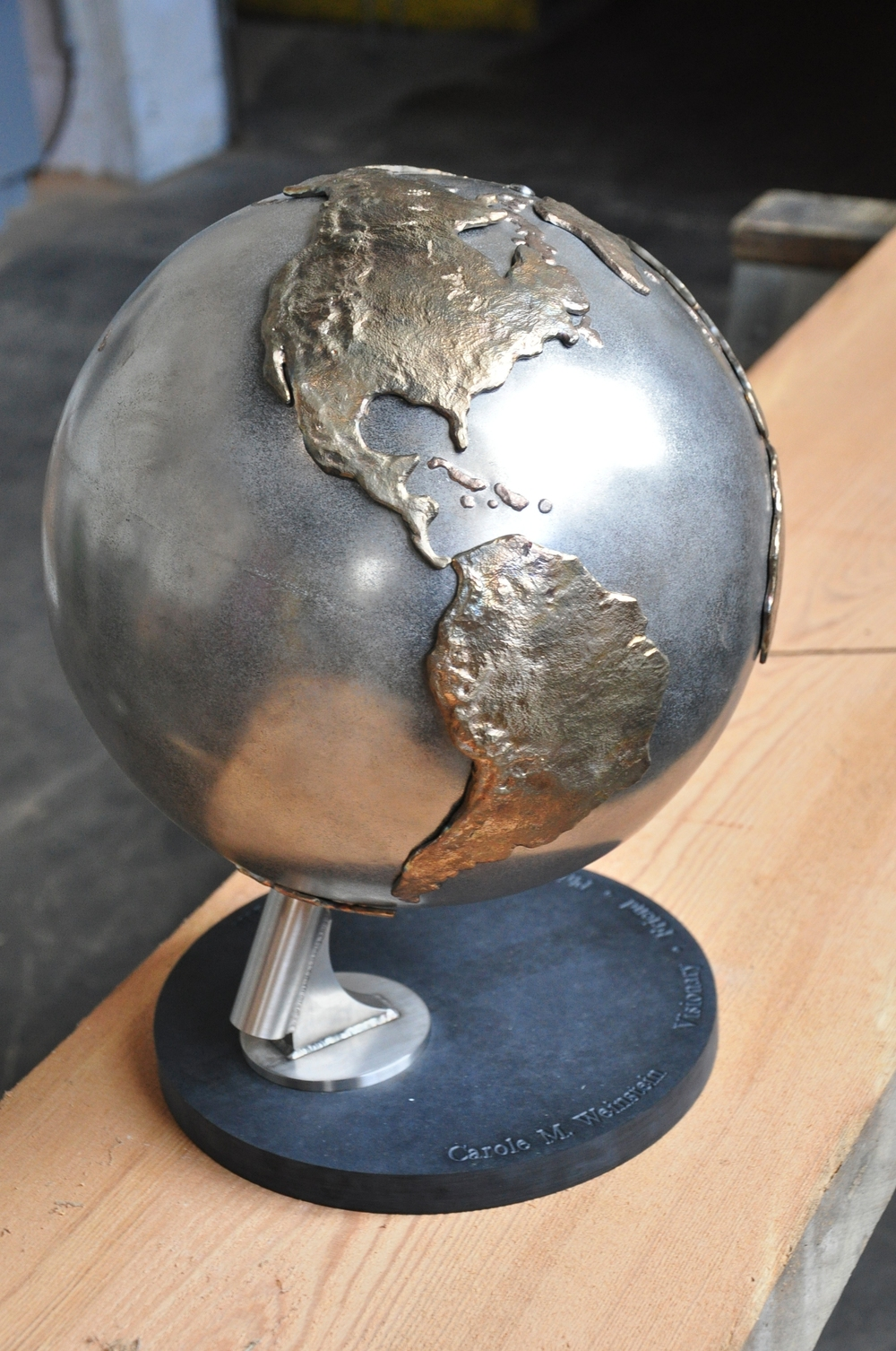 We first made a maquette to understand how the parts would go together :  the bronze continents are welded onto a stainless steel sphere, which is suspended on a steel rod, which rests in a pivot. At the conclusion of the project, this globe was given to Carole Weinstein.