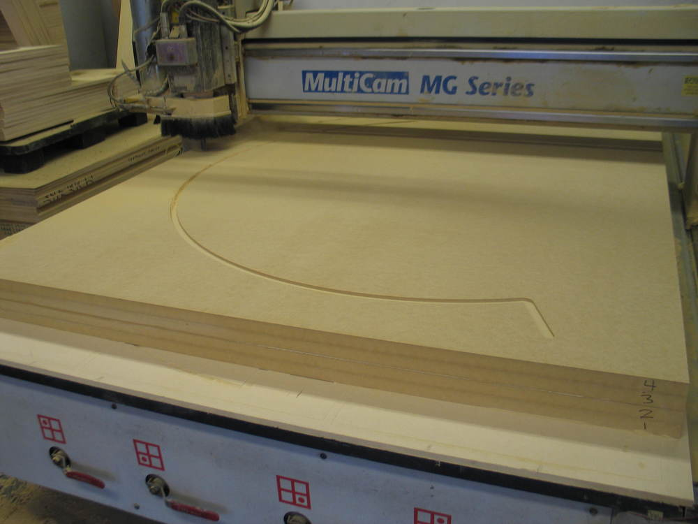 We glued up sheets of MDF and used our Multicam CNC router to machine out the elements that would be stacked to form the hemisphere.