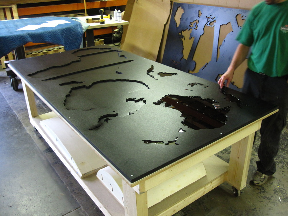 We used the router again to cut the shapes of the continents out of a sheet of PVC plastic.