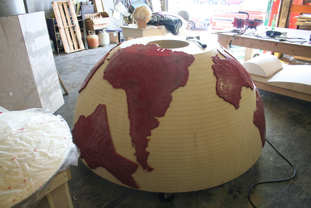 The continents will eventually be cast in bronze, but must first be made in wax, and then draped over the hemisphere to achieve the correct curvature.