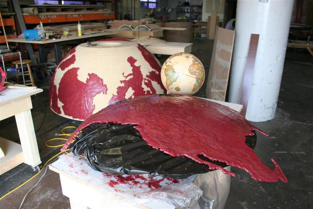 While the wax was still pliable, the pieces were draped and shaped over the MDF hemisphere. Once cooled, topography features were added using additive and subtractive sculpting techniques.