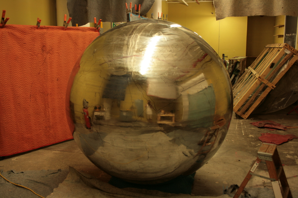 Rough outlines of continents have been drawn onto the sphere.