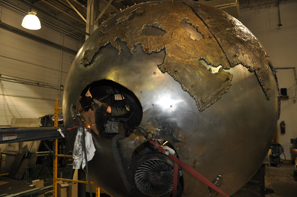 We needed to get inside the globe to do this. We cut a hole in the sphere--behind Africa--and installed a series of appropriate weights.