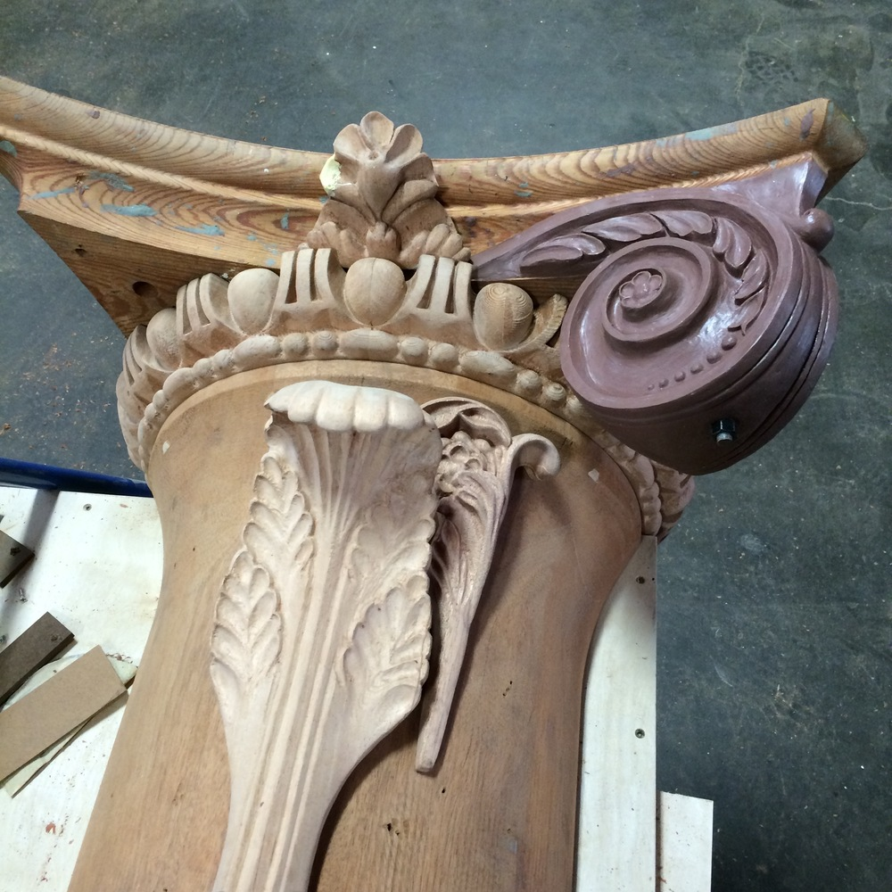 This is the process for each individual element of the capital. As each wooden part is completed, it can become part of the assembly. Seen here are the bell, the egg-and-dart, the bead-and-reel, the large acanthus leaf, the flower, and the fleuron (at the top center ).  The clay volute seen here will be the next part machined from wood.