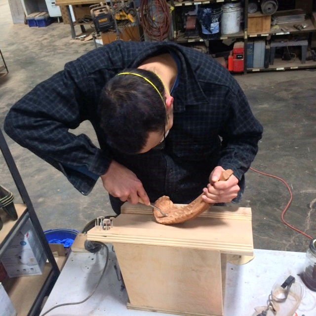 Aidan cleans everything up and makes all the carved edges more tightly finished.