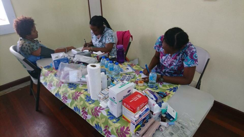Team of volunteer doctors and nurses giving medical aid in Dominica