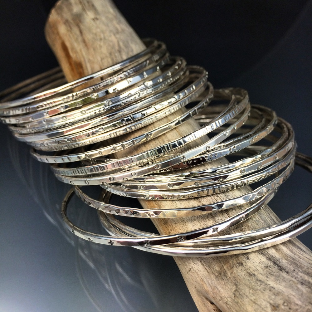 This 3 day workshop is $800. All materials are included (enough silver sheet and tubing to cap and core 4 beads and enough silver wire to make 3 bangles). We supply lunch, plenty of drinks and snacks as well. A $400 deposit is required to hold your spot in class. The balance is due a month before the workshop. Cancellation Policy:  10% of fee is considered non-refundable in cases of withdrawal for all students up to 30 days of the workshop.  Course fee is non-refundable within 30 days of the workshop unless I am able to fill the student's spot, in which case #1 above still applies.  If I cancel a class then 100% of your fee will be reimbursed. Classes are limited to 6 students.
