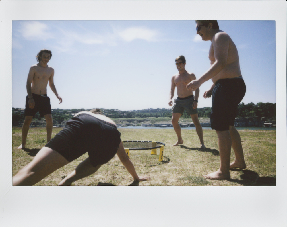 Sam, Max, Aaron, and Spencer playing Spikeball