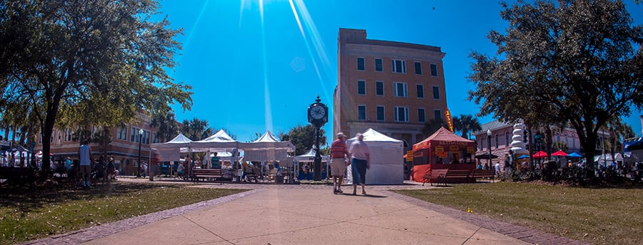 The 2015 Leesburg Art Festival. This is actually one frame from a one-hour time lapse I shot while I was there. What makes it more fun is the beautiful old town square clock in the center. ©2015 Steven Paul Hlavac.