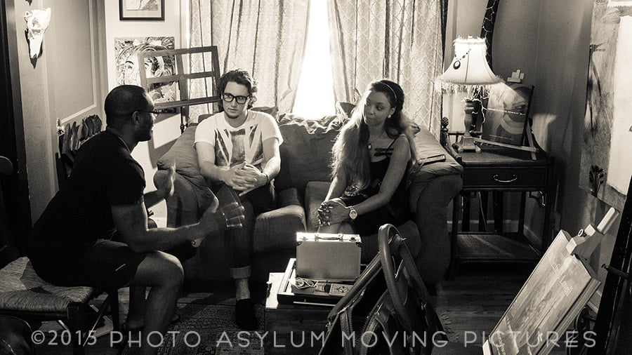 This appears to be a behind-the-scenes meeting, and that's the idea. It is actually a scene from my first commercial video, shot for The Andrew Roman Group. Left to right: Andrew Roman, Spencer Graham, Ariel Isabella. Location: Norm's Palette, Mount Dora, Florida. Screenshot ©2015 Steven Paul Hlavac/Photo Asylum Moving Pictures.