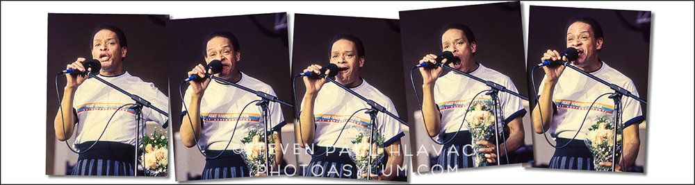 Al Jarreau's facial expressions as he sings are as much a part of his personality and his performance as the music. I don't remember why he had the flowers, but it made for an interesting prop. Photos ©Steven Paul Hlavac. All Rights Reserved.