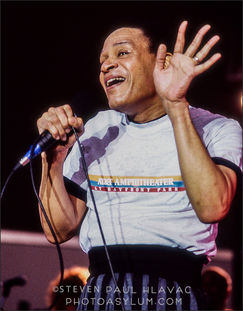 An exciting moment for me as I got to meet and photograph jazz great Al Jarreau during his appearance at...why just ask the shirt! AT&T Amphitheater at Bayfront Park in Miami in 1994. I can tell, looking at this shot, that I used a telephoto lens, but don't let that fool you. I was still pretty darn close to the stage. Photo ©Steven Paul Hlavac. All Rights Reserved.