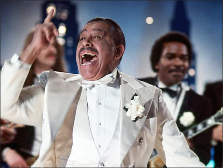 Calloway had a big role in the outrageous 1980 John Belushi, Dan Aykroyd comedy farce, The Blues Brothers, starting out as a relatively normal character, then changing near the end into his iconic and flamboyant performer role, singing, what else? Minnie the Moocher. Photo © Universal Studios