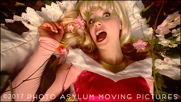 Model Lisa Fuhr reacts as I swoop in shooting hand held video with a wide angle lens during a break from her photo shoot with Kareen Rashelle. Screenshot ©Photo Asylum Moving Pictures/Steven Paul Hlavac. All Rights Reserved.