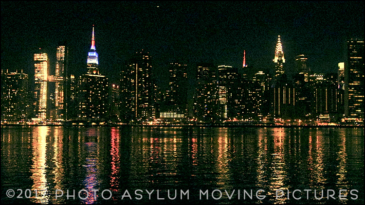 Not the best view of Manhattan's skyline, but the dramatic night lighting of New York City's iconic Chrysler and Empire State buildings is always special. Screenshot ©Photo Asylum Moving Pictures/Steven Paul Hlavac. All Rights Reserved.