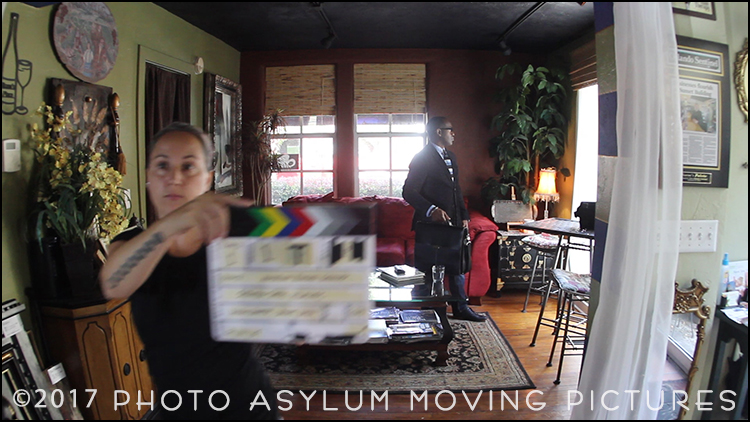 Assistant Justina Newman works the clapboard in a scene from my first commercial video production for The Andrew Roman Group, filmed at Norm's Palette in Mount Dora, Florida.  Screenshot ©Photo Asylum Moving Pictures/Steven Paul Hlavac. All Rights Reserved.