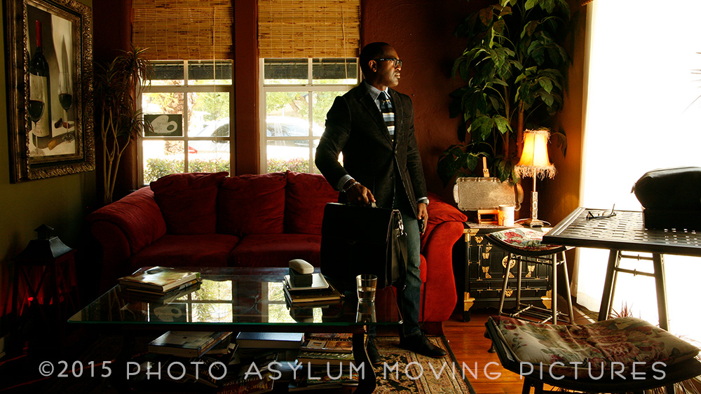 Client Andrew Roman in a scene from a promotional video, filmed at Norm's Palette in Mount dora. This was in the front room. Great decor and lighting meant I didn't have to change a thing to have it ready to shoot. ©Photo Asylum Moving Pictures.