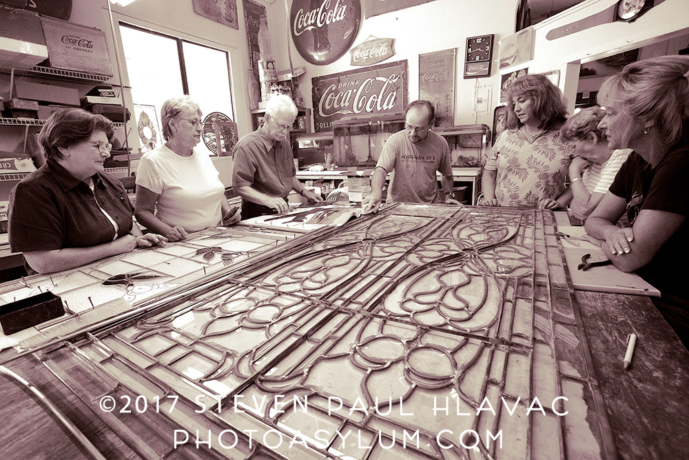 A fun wide angle shot I took for a for a January 2007 Lake and Sumter Style Magazine article on Old South Stained Glass owner Bob Treen, shown here giving a class on lead came stained glass. Photo ©Steven Paul Hlavac. All rights reserved.
