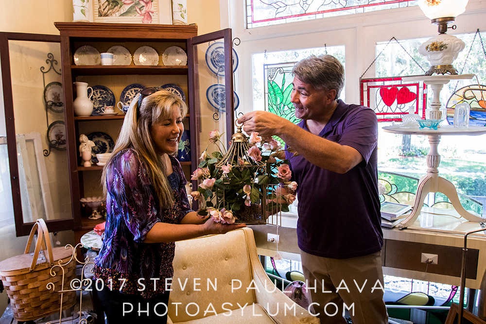Mount Dora power couple Janet Gamache and Brian Young at Old South Stained Glass Studio. Who says he never gives her flowers? Old, dusty, fake flowers, maybe, but flowers nonetheless. ©Steven Paul Hlavac. All rights reserved.