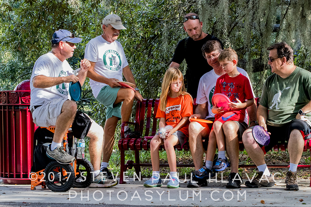 Disc golf seems to be a great family sport. Members of the Lake County Disc Golf Club relax in Lincoln Avenue Park in Mount Dora. ©Steven Paul Hlavac. All rights reserved.
