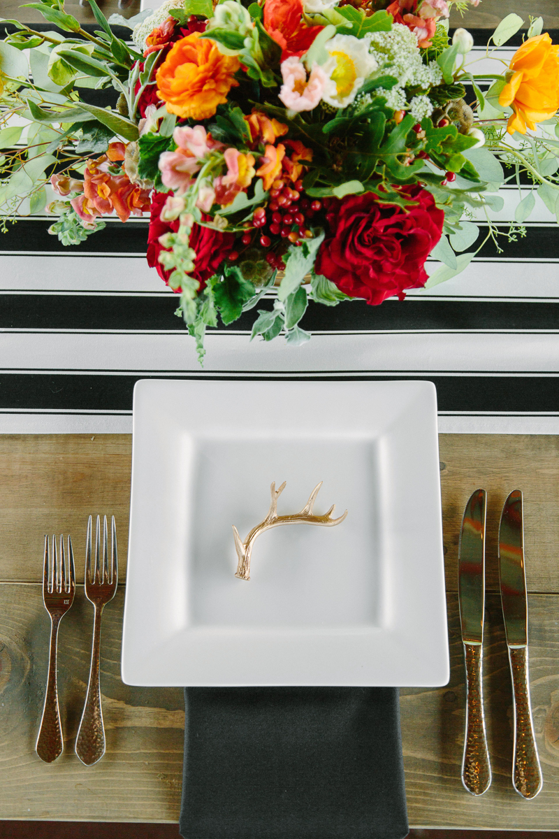 Marsala wedding flowers with black and white strip rustic tables / Aspen wedding photographer / www.catmayerstudio.com