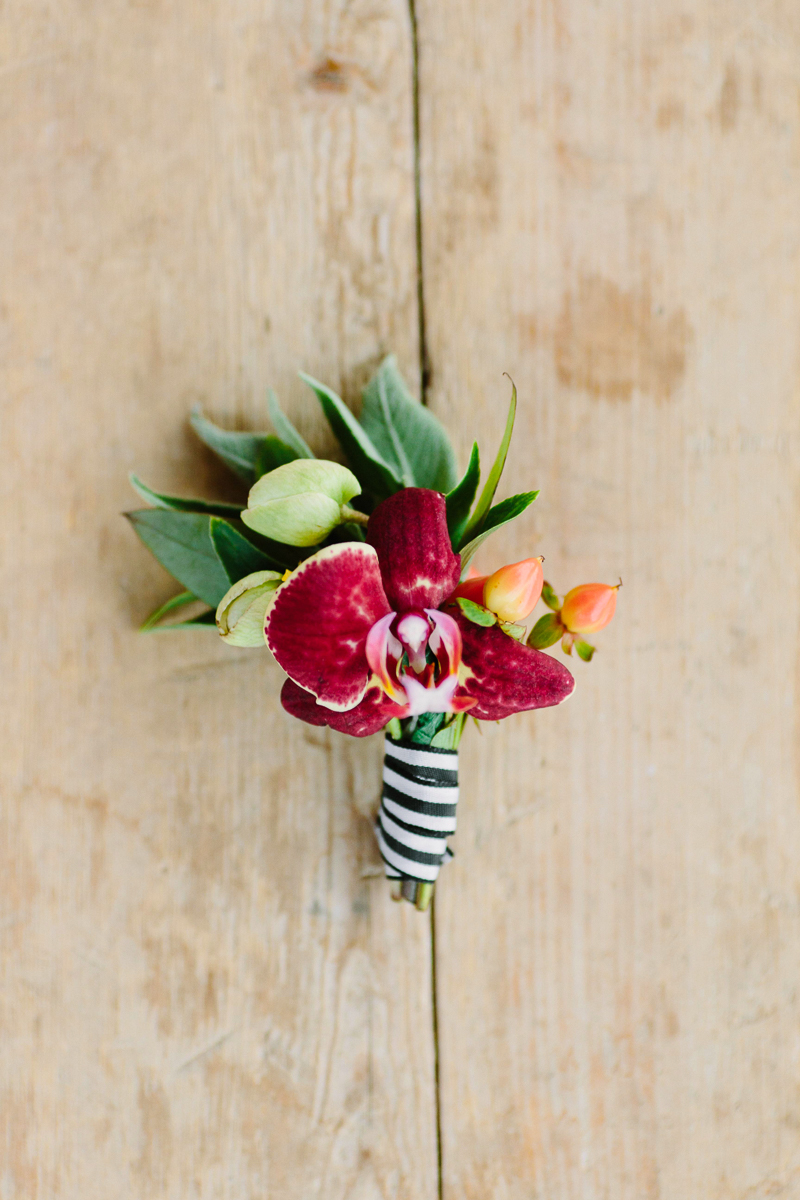 Groom's boutonniere with orchid and stripe ribbon by 3 Leaf Floral / photo: Cat Mayer Studio
