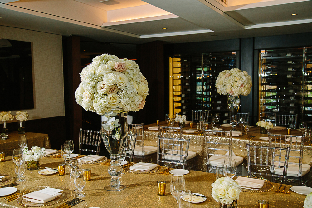Gold wedding reception at The Little Nell designed by Bella Event Design & Planning with flowers by The Aspen Branch
