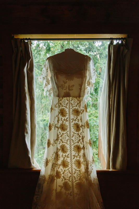 Lace wedding dress hanging in window | Design: Rue de Seine | A&Be Bridal Denver | Alta Lakes Wedding | Cat Mayer Studio