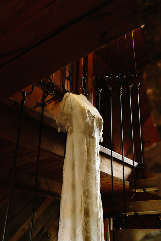 Rue de Seine lace wedding dress hanging in stairway | Alta Lakes Observatory | Cat Mayer Studio