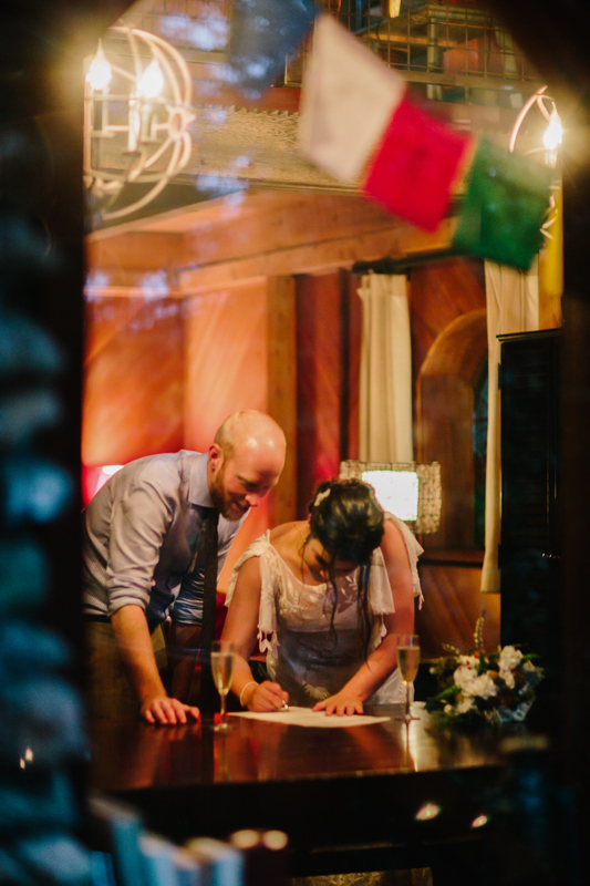 wedding couple signing marriage license through window at night | Alta Lakes Observatory | Cat Mayer Studio
