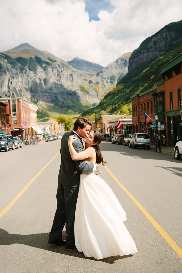 Bride and groom in street in Telluride / Cat Mayer Studio