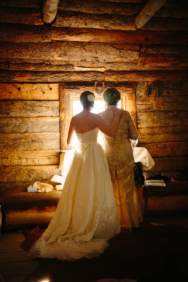 Bride with her mother looking out window | Gorrono Ranch Saloon | Telluride, Colorado | Photography by Cat Mayer Studio