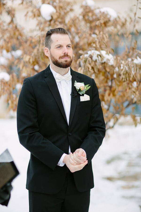 Groom watching bride walk down aisle | Beaver Creek winter wedding | Photography by www.catmayerstudio.com