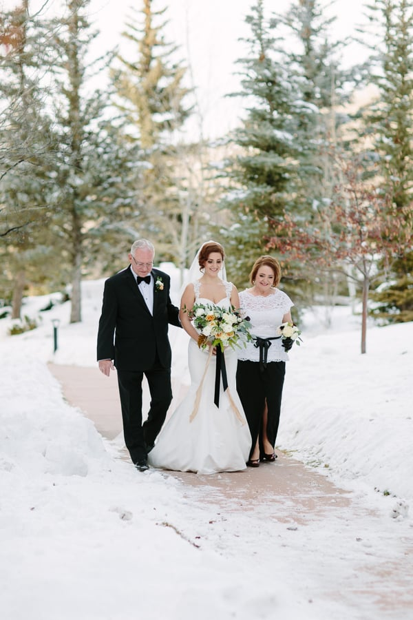 Bride walking down aisle with both parents | Winter wedding at Park Hyatt Beaver Creek, Colorado | Photographer: Cat Mayer Studio www.catmayerstudio.com