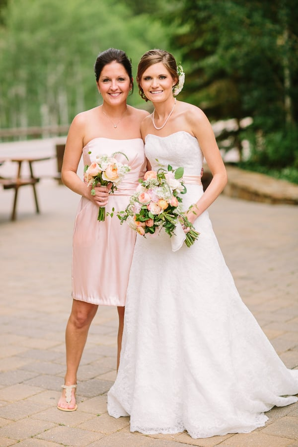 Bride and maid of honor with pink pastel wedding | Ritz Carlton Bachelor Gulch | Vail wedding photographer Cat Mayer Studio www.catmayerstudio.com | Floral design by www.3leaffloral.com