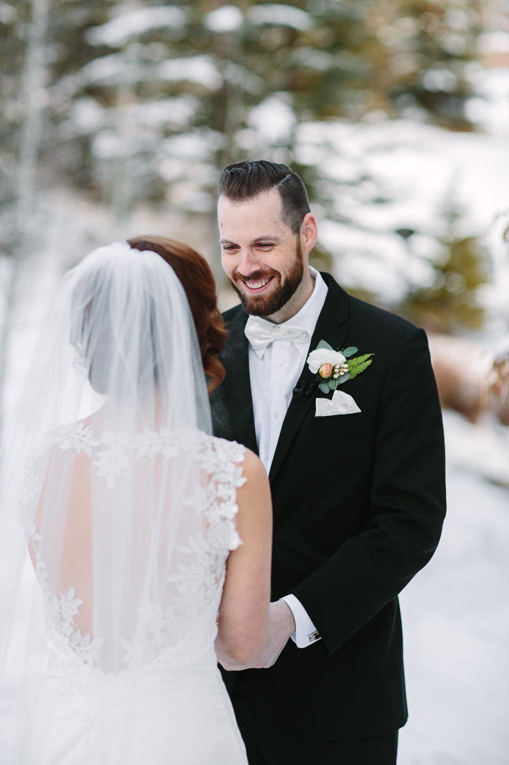 Cat Mayer Studio | www.catmayerstudio.com | Vail Wedding Photography | Park Hyatt Beaver Creek winter wedding | Groom smiling at bride