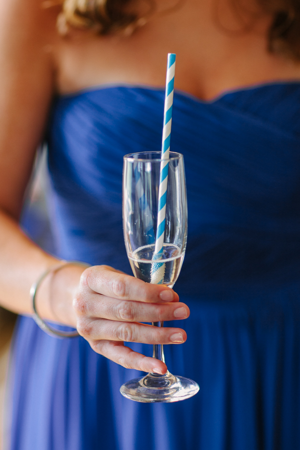 Cat Mayer Studio | www.catmayerstudio.com | San Sophia Wedding | Blue bridesmaid dress with Champagne and straw