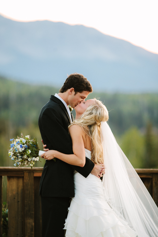 Cat Mayer Studio | www.catmayerstudio.com | Gorrono Ranch Telluride Wedding Reception | Bride and groom kissing at sunset