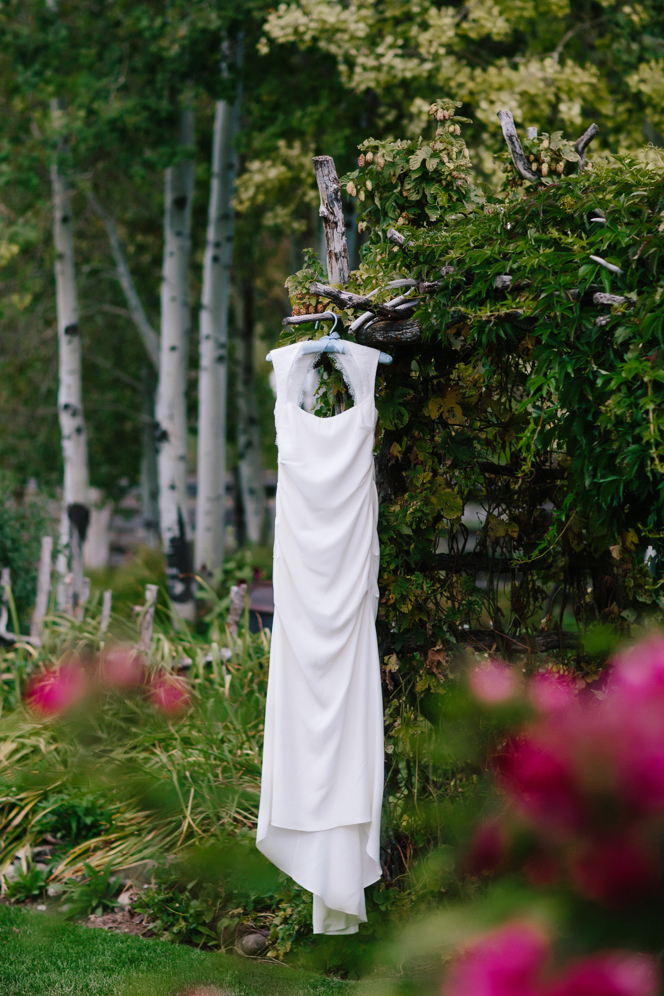 Aspen Wedding Photography | Wedding Gown Hanging in Woods | Photography by Cat Mayer Studio | www.catmayerstudio.com